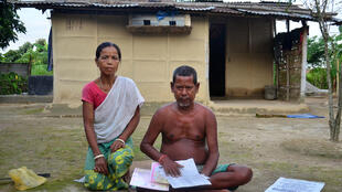 A man and his wife in Bamunigaon village in Assam. The 58-year-old fled Bangladesh as an infant and has lived nearly his whole life in India, which has declared him a foreigner.
