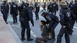 Police arrest a demonstator in Albi after Fraisse's death