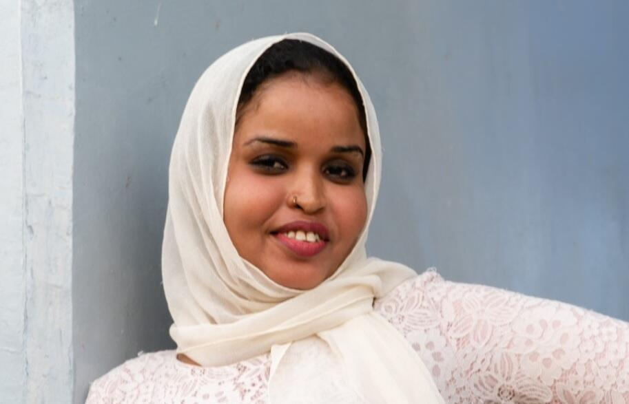 Vocalist Asma Omar, 20, is the youngest member of Groupe NTD, and its only female.