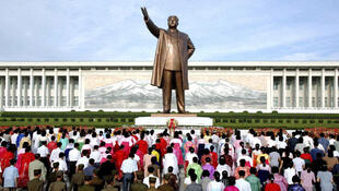 North Koreans offer flowers to a statue of the North's former leader and founder Kim Il-Sung in Pyongyang