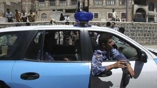 Yemeni police at the scene of the attack on the British embassy car