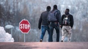 Migrants cross the Franco-Italian border through the Alps mountains.
