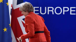Britain's PM May leaves after a news conference at the end of the EU summit in Brussels on 21 October 2016.