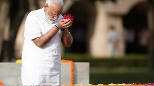 Narendra Modi pays his respects at the Mahatma Gandhi memorial ahead of his swearing-in ceremony, in New Delhi, India May 30, 2019.