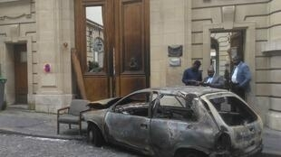 The wreck of the Opel Corsa used to ram the embassy