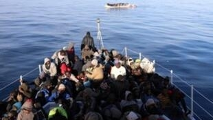 Migrants are seen as they are rescued by Libyan coast guards in the Mediterranean Sea off the coast of Libya, January 15, 2018.