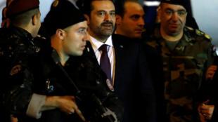 Firaministan Lebanon mai marabus Sa'ad Hariri kewaye da jami'a tsaro a birnin Beirut
