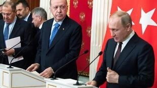 Russian President Vladimir Putin and Turkish President Tayyip Erdogan attend a news conference following their talks in Moscow, Russia March 5, 2020.