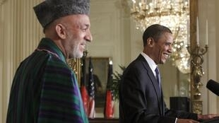 Friends together - Karzai (L) and Obama at Wedesday's press conference