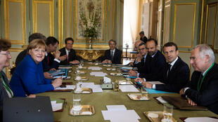 German Chancellor Angela Merkel, French President Emmanuel Macron and French Prime Minister Edouard Philippe attend a meeting as part of a Franco-German joint cabinet meeting at the Elysee Palace in Paris, France, July 13, 2017.