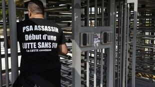 A worker protests at closure plans at Peugeot-Citroën's plant at Aulnay-sous-Bois.