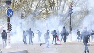 Youths clash with police on hte margins of the Paris anti-labour law demonstration, 29 April 2016