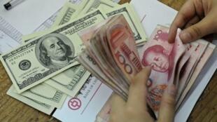 Trung Quốc bị tố cáo ghìm giá đồng nhân dân tệ thấp hơn từ 20% đến 40% so với giá trị thực. Ảnh minh họa.