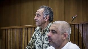 Mohamed Timol (L), brother of late anti-apartheid activist Ahmed Timol and Imtiaz Cajee (R), his nephew, at the court