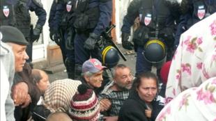 Police clear a camp in Saint-Denis, near Paris