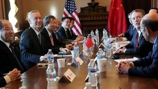 U.S. Trade Representative Robert Lighthizer (2nd right) sits across from China's Vice Premier Liu He (left) during the opening of US-China Trade Talks