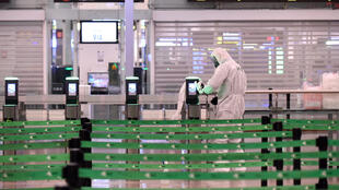 Members of Spain's Military Emergencies Unit (UME) carry out a general disinfection at Josep Tarradellas Barcelona-El Prat airport in El Prat de Llobregat on March 19, 2020