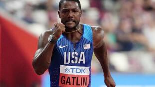 Justin Gatlin is trying to emulate Usain Bolt and defend a 100 metres title at the world championships.