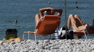Nice when you get there ... holidaymakers on the beach at Cagnes-sur-Mer