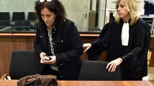 Rosa Maria Da Cruz (L) with her lawyer Chrystele Chassagne-Delpech (R) at the start of her trial