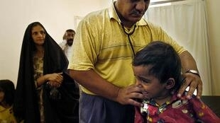 Iraqi doctor examining a child
