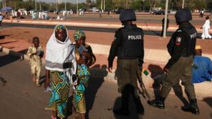 Nigerian police patrol as people attend prayers marking the muslim festival of Eid al-Adha in the capital Abuja