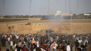 Israeli soldiers fire tear gas at Palestinians protesting in the Great March of Return