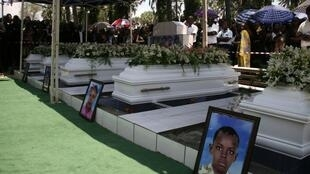 People attend the funeral of a Burundian journalist and his family and a member of the International Organization for Migration humanitarian team in Bujumbura on 20 October 2015, after they were shot dead on 13 October.