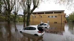 Cars are seen on a flooded street after heavy rain fall in Roquebrune-sur-Argens, France, November 24, 2019.