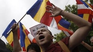 A Burmese monk at a protest against Myanmar's military ruler Than Shwe in New Delhi