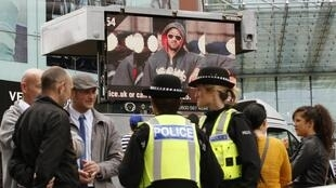 Rioter on a screen in London, August 2011