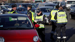 Police check vehicle licence plates in Paris on Tuesday