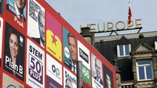 Election campaign posters seen on a hoarding in Amsterdam, Netherlands, March 11, 2017.