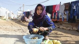A Syrian refugee at a refugee camp in Zahle in the Bekaa valley, 18 November, 2014