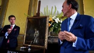 French auctioneer Aymeric and Philippe Rouillac present an unknown and unpublished painting by French painters Le Nain Brothers during an auction at the Artigny château on 10 June, 2018, in Montbazon.