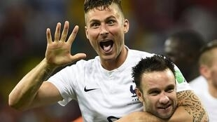 France's Olivier Giroud celebrates the win over Switzerland with Mathieu Valbuena