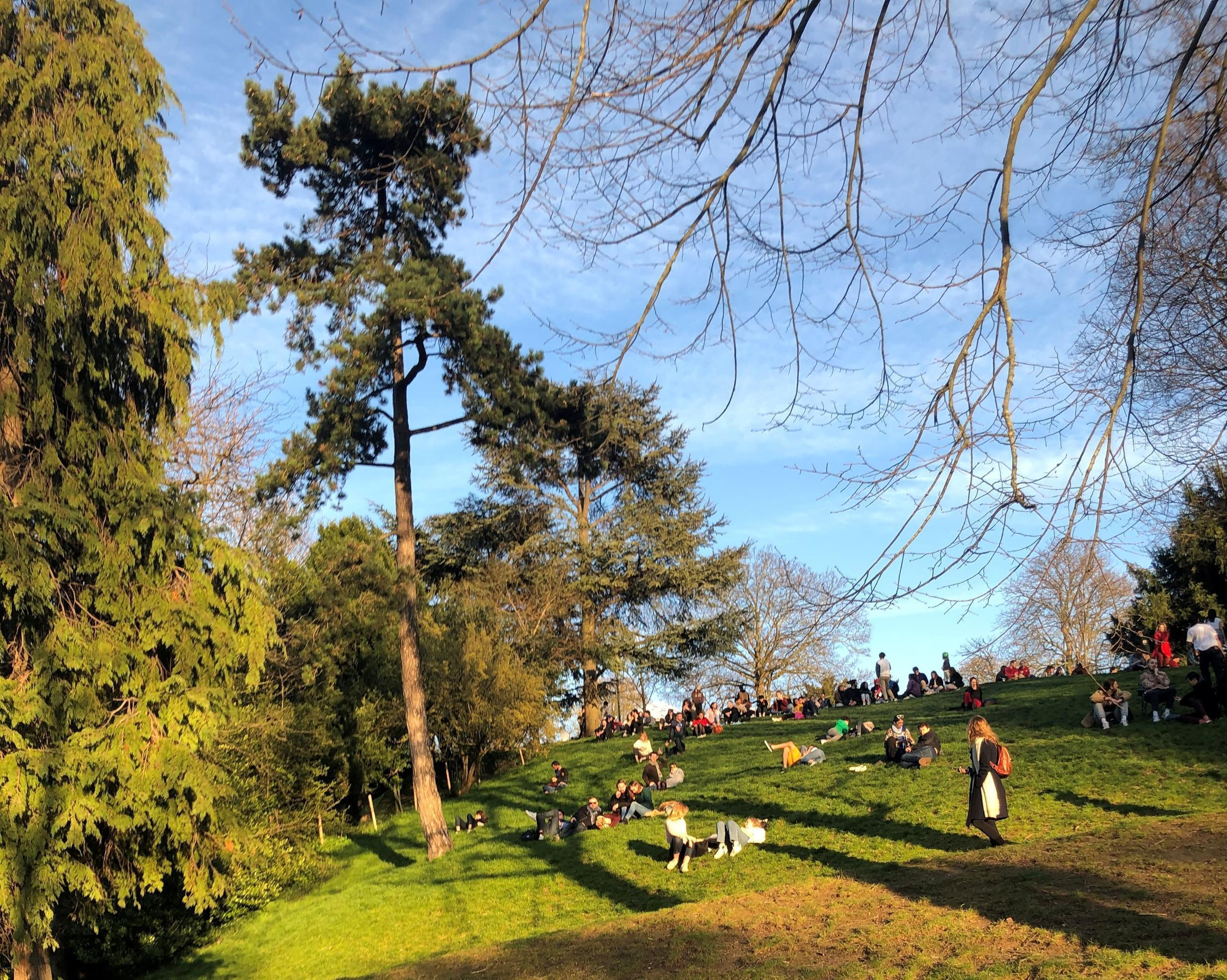 Parisiens gather to enjoy some spring sunshine at the Buttes Chaumont park at the weekend, ignoring government advice to stay indoors and respect social distancing.