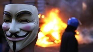 A masked protestor in Rome during violent street protests over the weekend