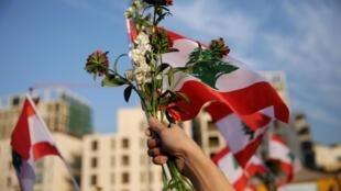 Manifestation populaire le 22 novembre à Beyrouth. «Révolution, révolution», ont scandé les participants à ces marches, dont un grand nombre de familles.
