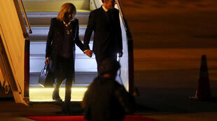 French President Emmanuel Macron and his wife Brigitte arrive in Buenos Aires