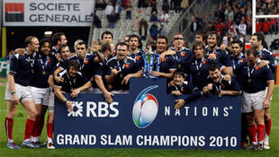 France's rugby players celebrate at the Stade de France after winning the Six Nations rugby union tournament