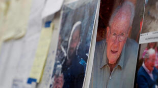 Портреты пропавших без вести в ходе пожаров в Калифорнии, размещенные в эвакуационном пункте в Чико.