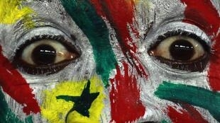A Senegal fan watches his team play Equatorial Guinea