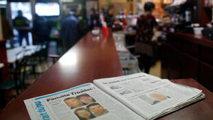 A newspaper sits on the counter of a neighborhood bar near the house of the Troadec family in Orvault, near Nantes, France, March 1, 2017. The couple and their two children have been missing for nearly two weeks.