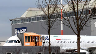 """An Airbus A321 with the Iranian flag and description """"The airline of the Islamic Republic of Iran"""" is parked at the Airbus facility in Hamburg on December 19, 2016"""