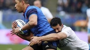 Fickou being tackled by Italy's Andrea Masi during France's Six Nations match in Rome, 15 March 2015