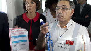 Health Minister Marisol Touraine and Dr Philippe Bargain, who heads the medical centre at Paris's Roissy-Charles de Gaulle, explain the new Ebola-screening measures