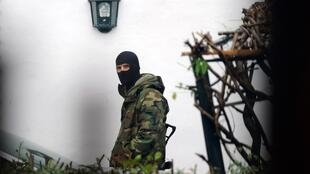 A French serviceman stands guard near a house were the most senior leader of the Basque separatist group ETA, Mikel Irastorza was found in the French town of Ascain, in the Pyrenees region bordering Spain, on November 5, 2016.