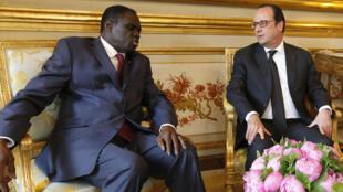 Burkina Faso's President Michel Kafando meets French President François Hollande in Paris in June