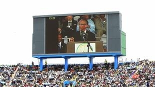 Rwandan President Paul Kagame shown on a big screen in Kigali's Amahoro stadium, 7th April 2014.